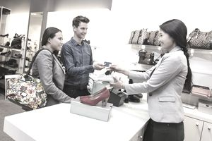 Two customers interacting with sales representative
