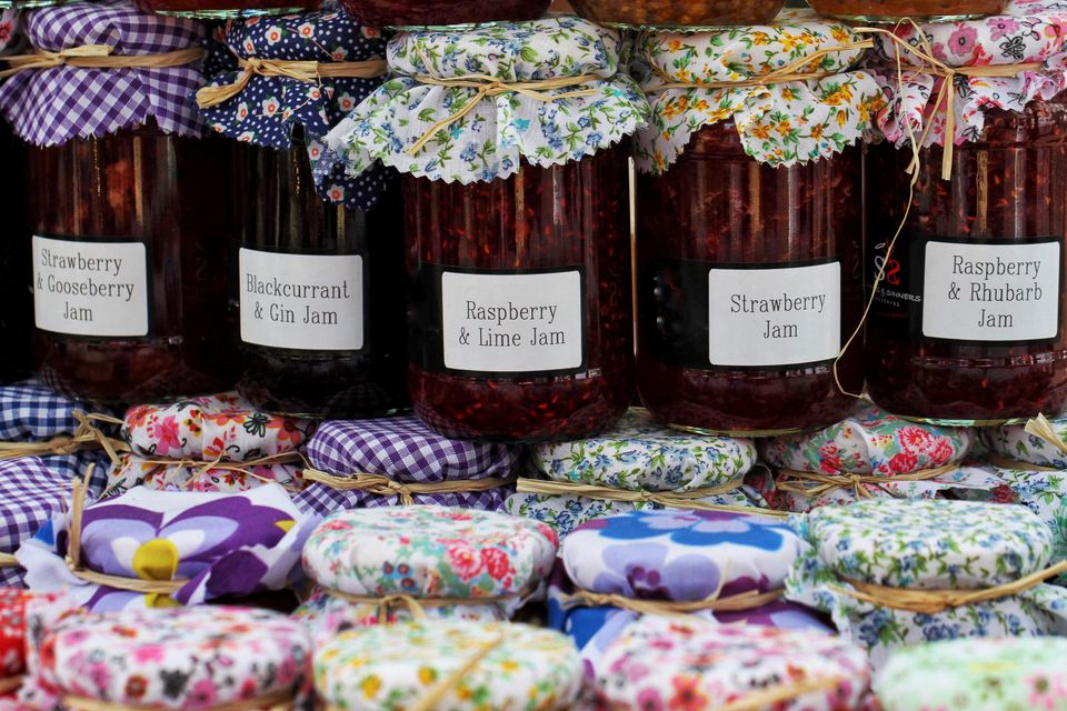 jars of homemade jam topped with fabric