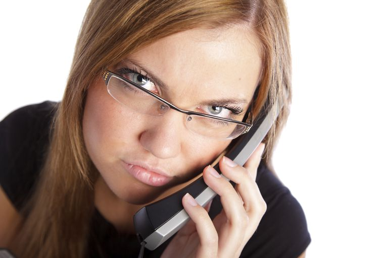 Woman on phone looking annoyed