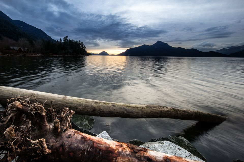 Sunset in Howe Sound at shore near Britannia Beach, BC, Canada