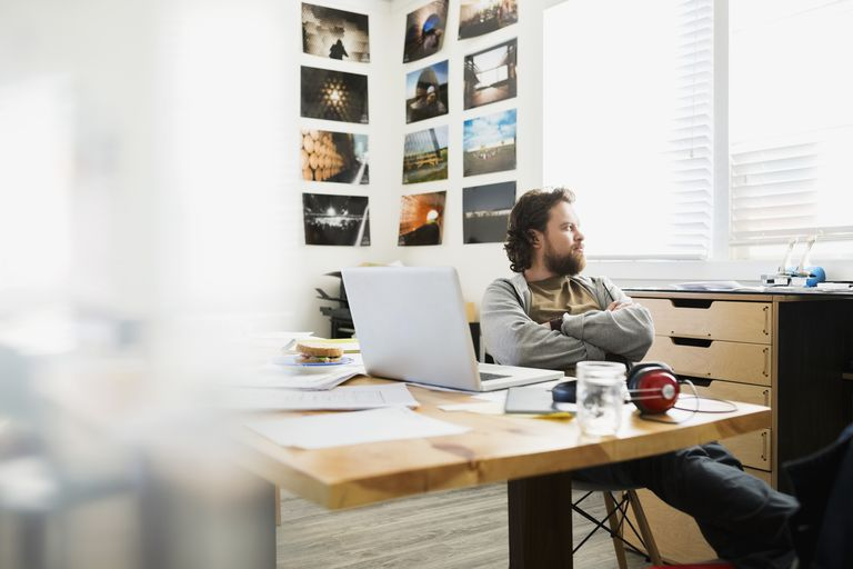 Pensive designer looking out office window