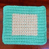 Crocheted Afghan Block Featuring Two-Tone Nested Squares