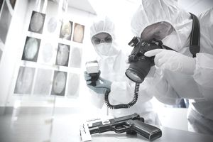 Forensic scientists examining gun