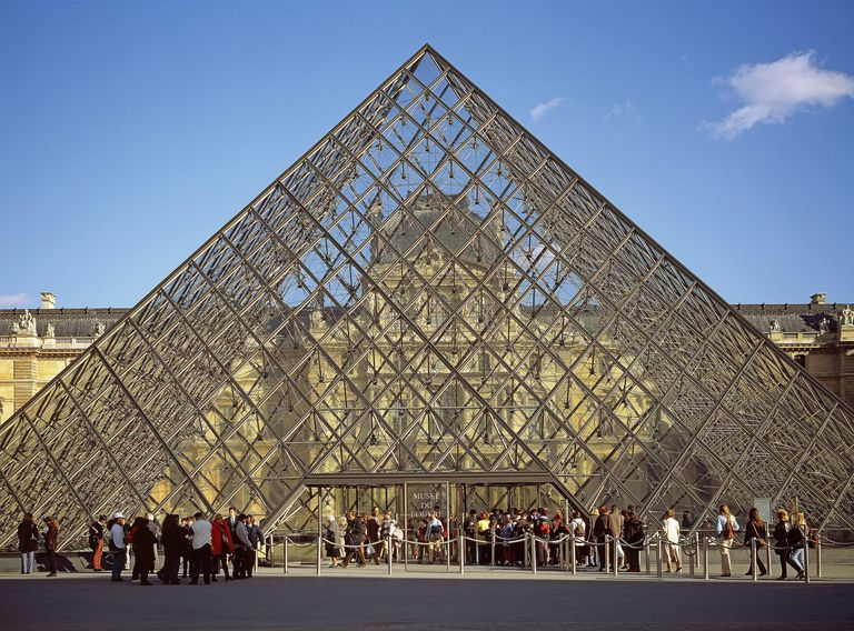 People queuing by Pyramide du Louvre in Paris. The glass pyramid was designed by I.M.Pei