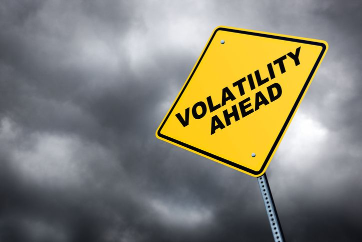Volatility Ahead road sign over gray skies