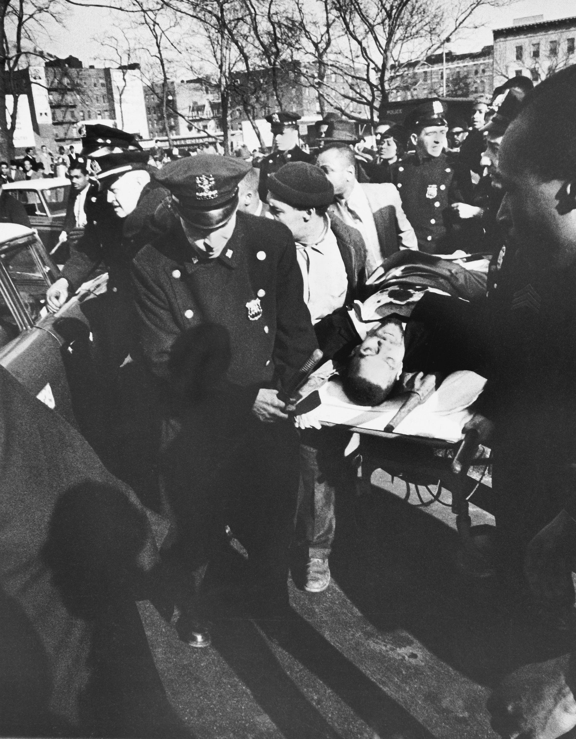 Malcolm x and martin luther king jr similarities malcolm xs body being carried on a stretcher after his assassination pooptronica