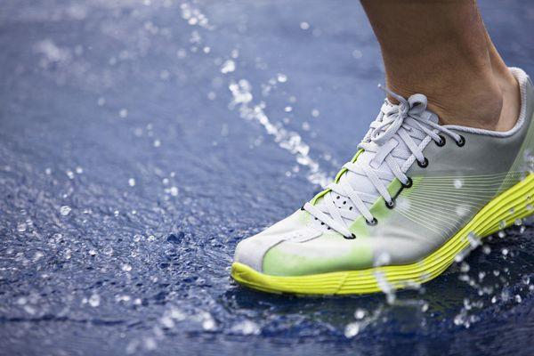 running shoe splashing water