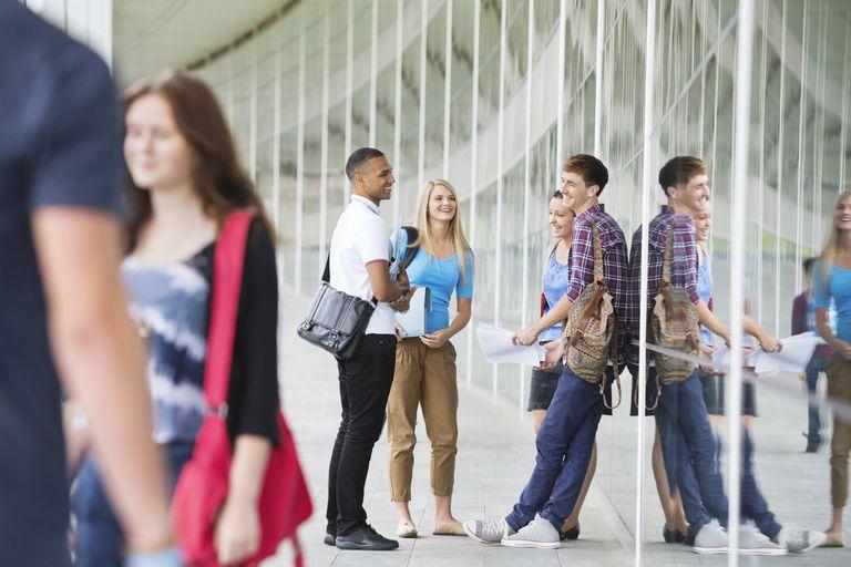 Teens talking in hallway at school