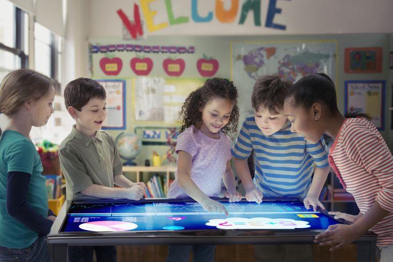 Children do art activity in classroom