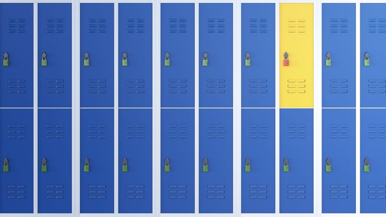 Contrast - one yellow locker along a line of blue ones
