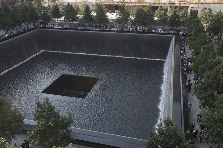 A square pool of flowing water, part of the National 9/11 Memorial in New York City