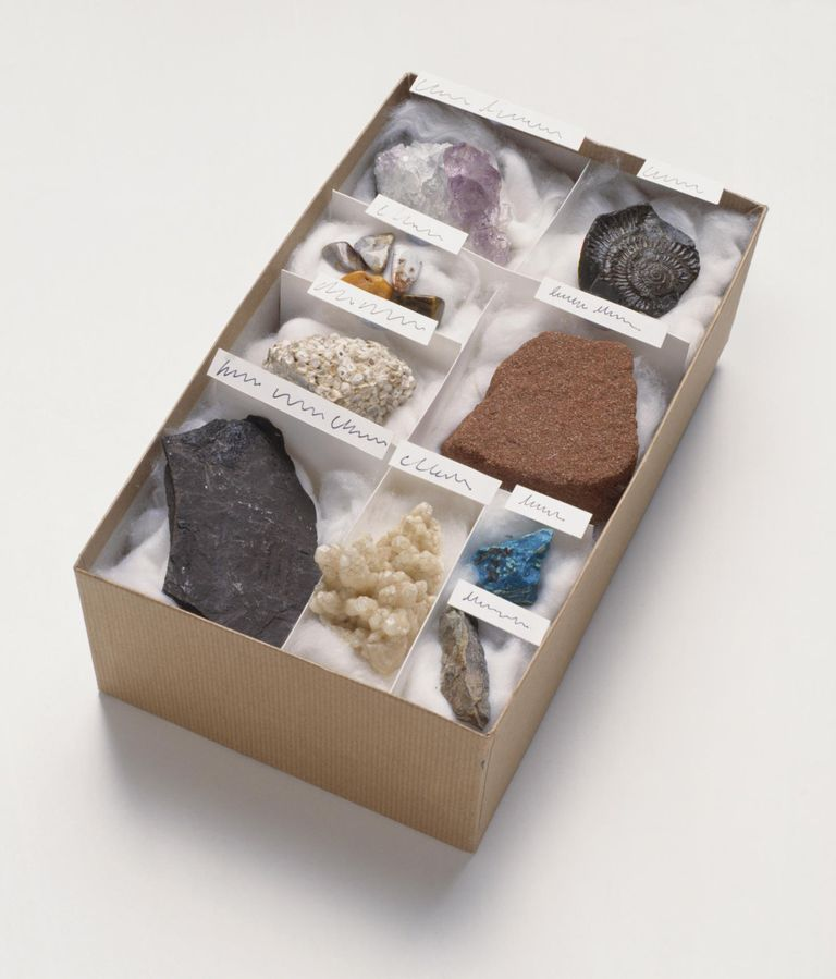collection of minerals and rocks in a box