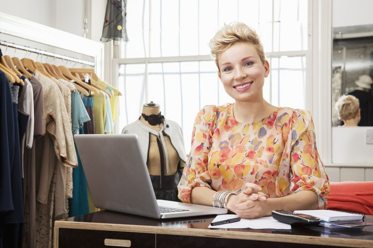 woman in retail store at laptop