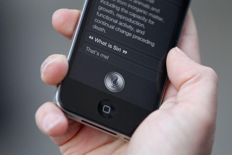 Man using Siri on phone