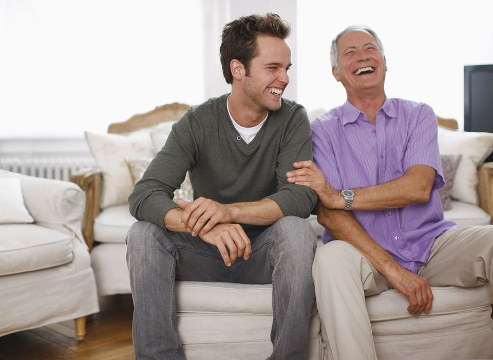 father and son laughing