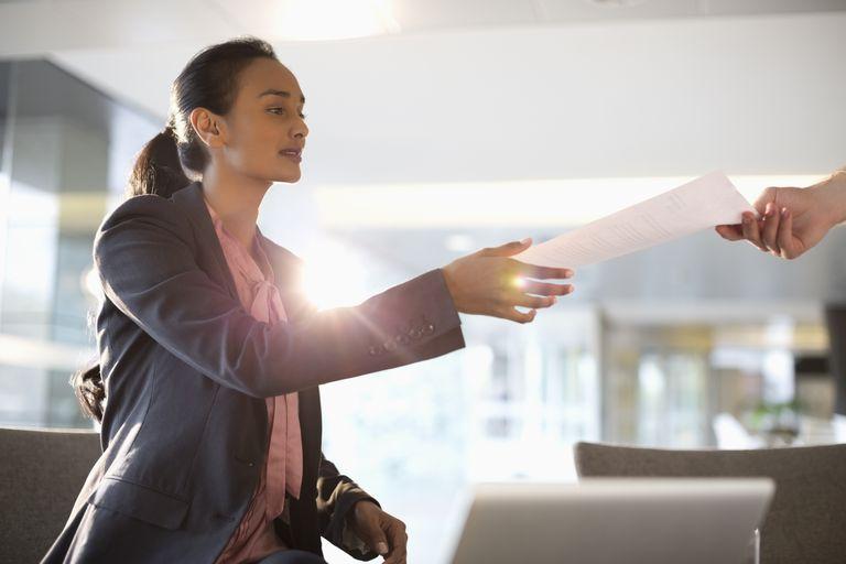 Woman taking paper