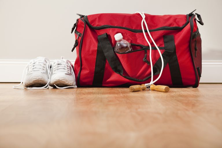 Sport bag with jump rope and sport shoes