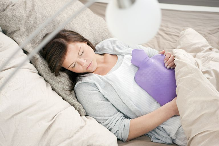 Woman sleeping with a hot water bottle