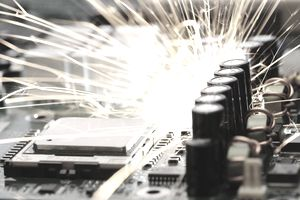 Sparks flying off electronic machinery