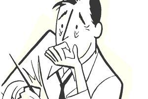 Worried businessman working at desk
