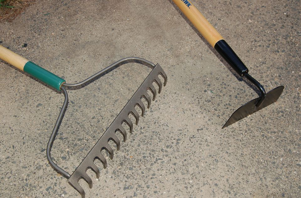 Garden tool images: a steel rake and a hoe.