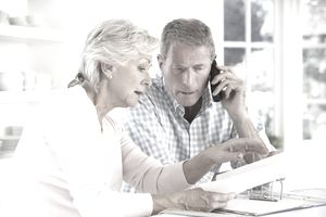 Couple on phone with annuity customer service.