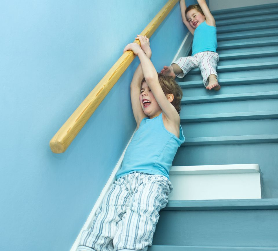 children sliding from staircase