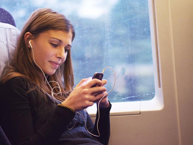 Woman checks cell phone