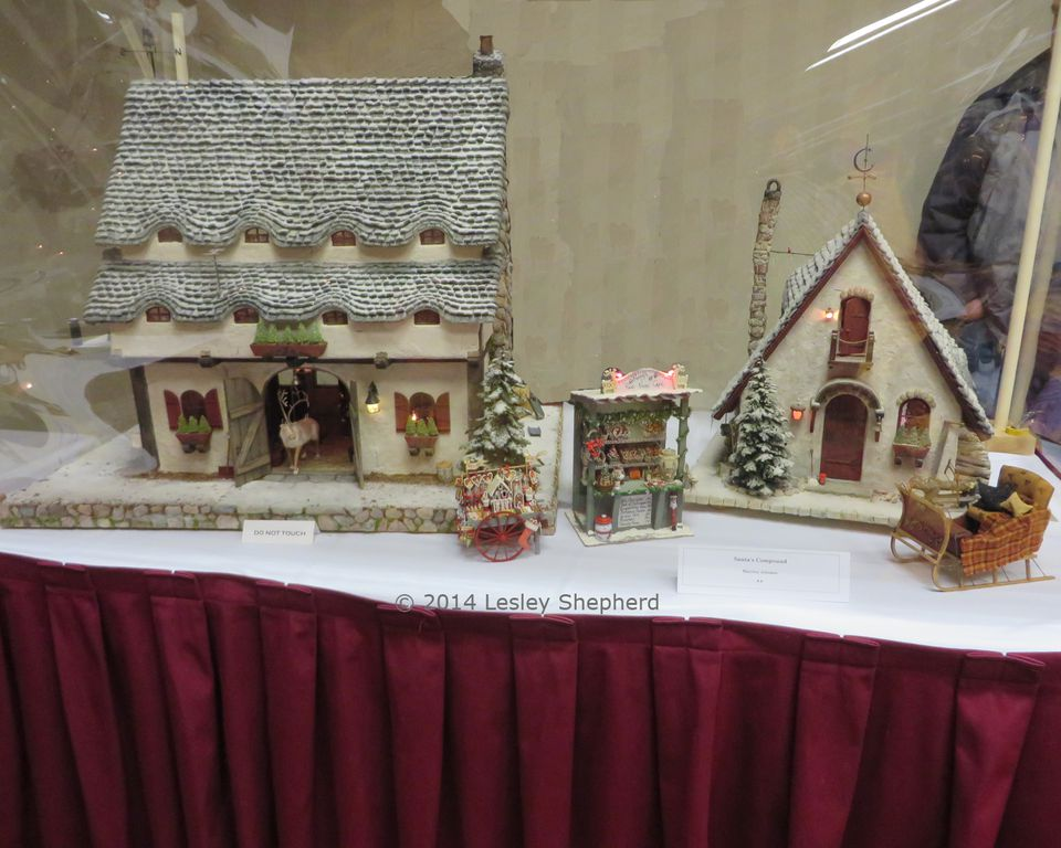 Dollhouse scale display of Santa's compound with a reindeer barn, Santa's Workshop and more.