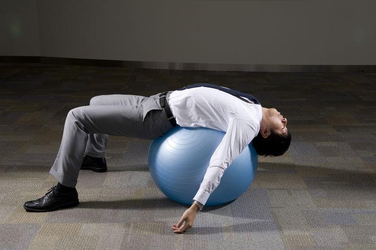 business man streaching his back using Balance Bal