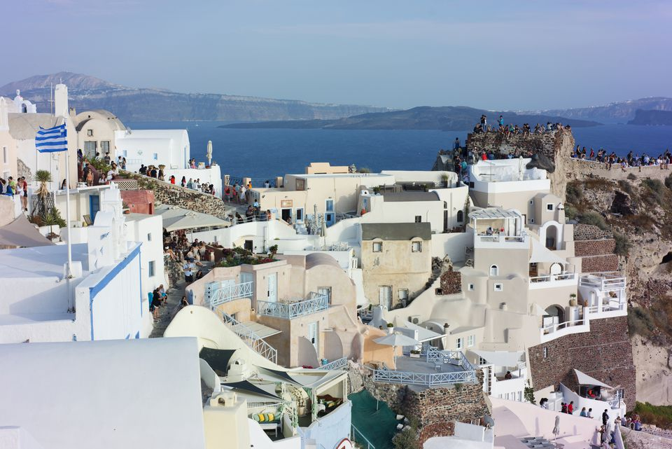 Visitors assemble early for a good spot to watch the sunset in Oia.