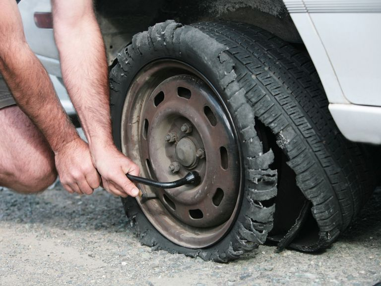 replacing a tire blowout