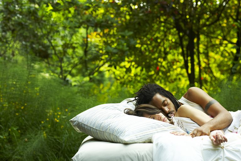 Couple sleeping in nature