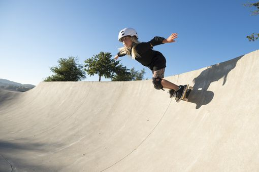 10 year old child physical development - girl on skateboard