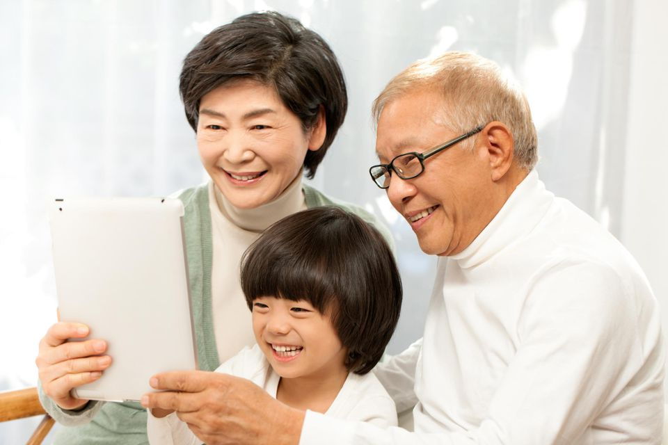 Family using digital tablet to FaceTime
