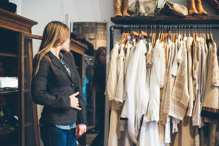 Woman trying on jacket in store