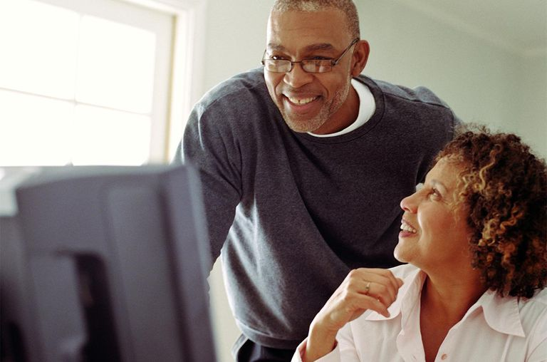 Mature couple working in home office