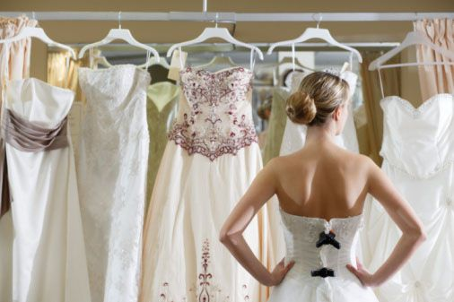 Picture of a woman looking at wedding dresses