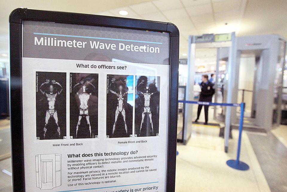 CHICAGO, IL - DECEMBER 15: A sign informs travelers about Millimeter Wave Detection technology used in full body scanners at Midway Airport December 15, 2010 in Chicago, Illinois. Transportation