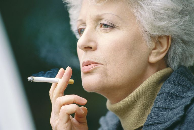 Senior woman smoking estimating the number of pack years