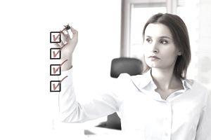 Woman making an HR checklist