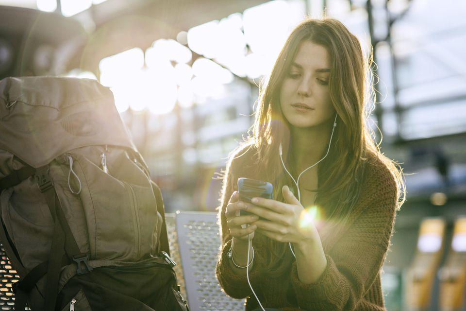 Woman with phone and backpack