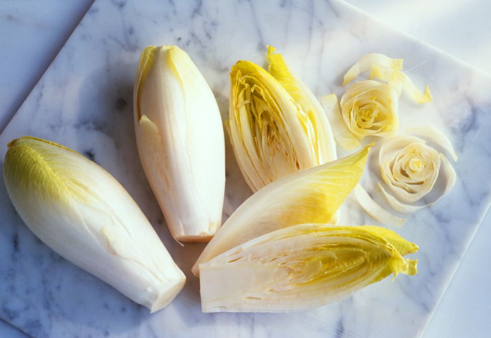 Chicory, whole and sliced, on marble board