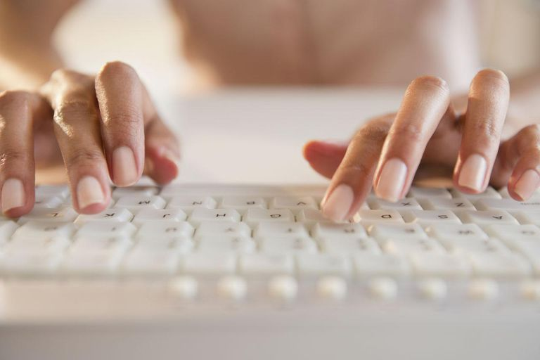 Cape Verdean woman typing on keyboard