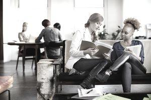 Businesswomen collaborating in creative workspace