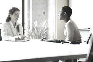 Two businesswomen in discussion in conference room