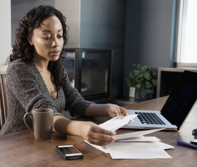 Black woman paying bills on computer