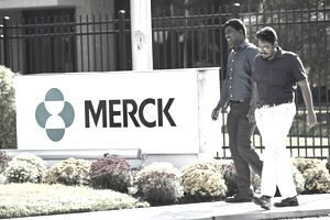 SUMMIT, NJ - OCTOBER 2: Employees walk past a Merck sign in front of the company's building on October 2, 2013 in Summit, New Jersey. The pharmaceutical company Merck & Co. announced today tha.