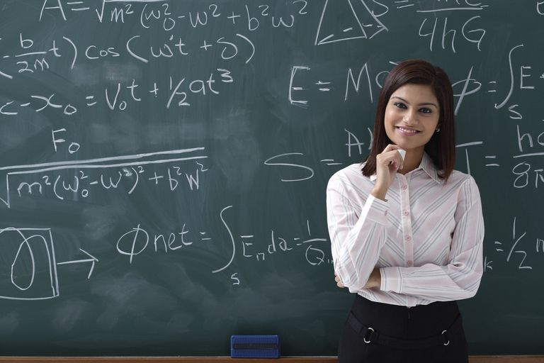 Woman standing proudly in front of chalk board