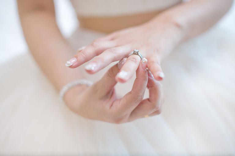 woman touching wedding rings